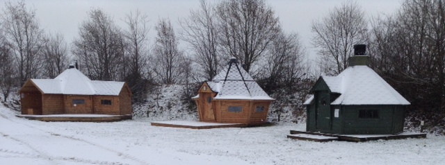 timber yurts in the snow on bindlebole wood