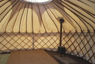 Inside canvas yurt at rivendale - with log burning fire
