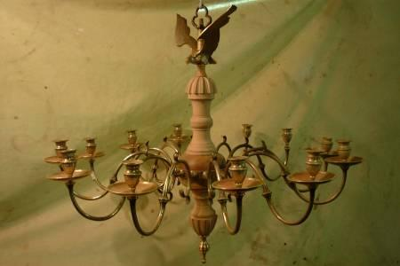 18th Century brass chandelier we restored this piece with pearwood turnings and carvings, this was then gilded, the wooden repairs can be used in the future to be made into moulds which can be cast in brass